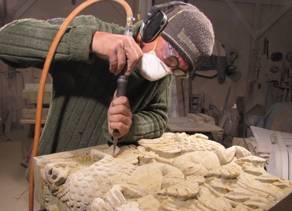 Dale Johnson carving a capital