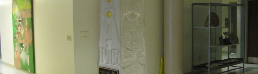 "Alpha Phi Alpha Obelisk, Hale Hall, Ohio State University Indiana Limestone, Glass, Gold Leaf, Bronze 9' x 14"" x 14"" Installed without power equipment with the members of the Fraternity."