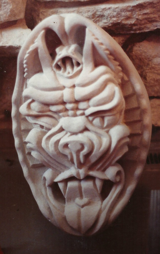 """One of my first carvings. Indiana Limestone, 18"""" tall, 10"""" deep. Check out the heart on the tongue."""