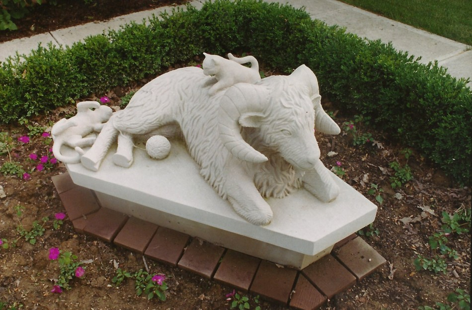 "This fun piece is the counterpart to the client's request for a Lion and Lamb sculpture for one entrance to the building; the other entrance needed a similar piece to maintain the ""feel"" of the landscaping, but we agreed that too much symetry is too much of a good thing. I get a kick out of the kitten's tail."