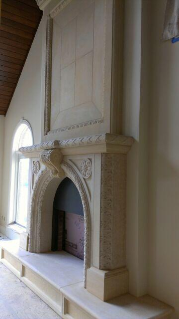 Karlsson Fireplace Mankato Limestone Design by Erik Karlsson Details carved by Dale Johnson 14' x 9' x 2'