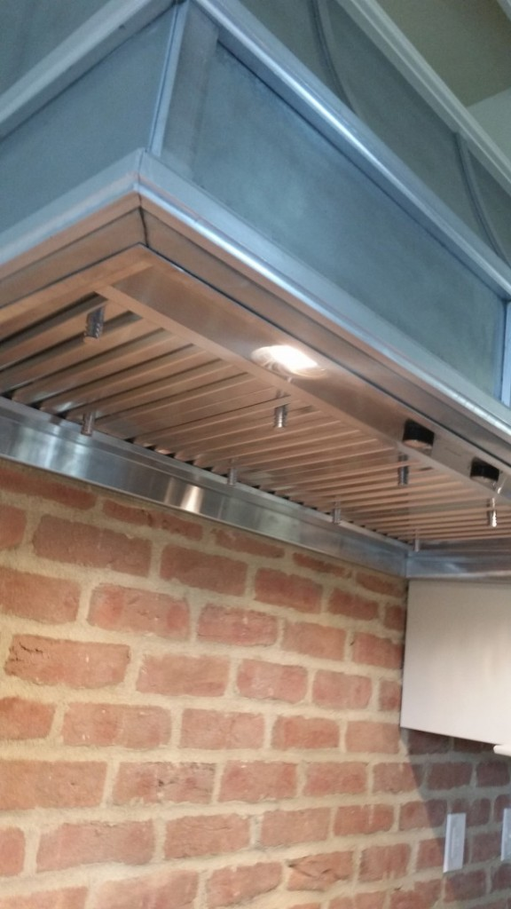 Zinc, Milled Aluminum, Oil finish, Stainless Steel Boy, this one was heavy when it was finished. I don't envy the installers!