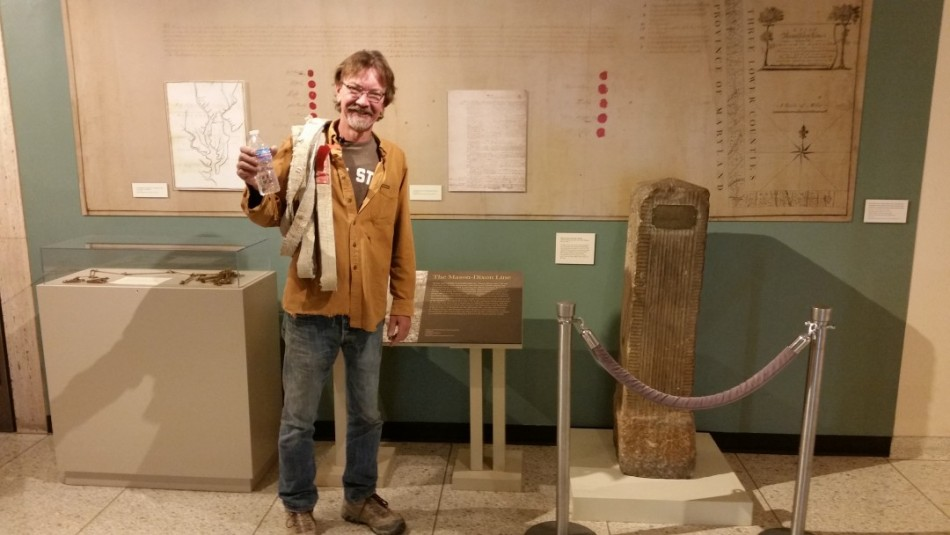 Me, in the Maryland Historical Society Museum with one of the original stones carved in England and brought over to form the border between Maryland and Pennsylvania.