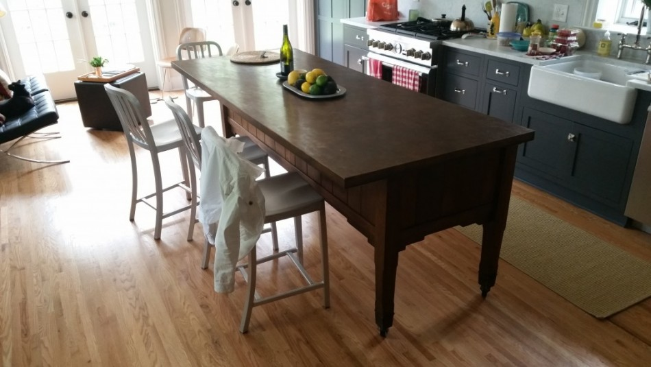 A brass counter patinated to a gorgeous dark leather brown. Nice look, nicely done.